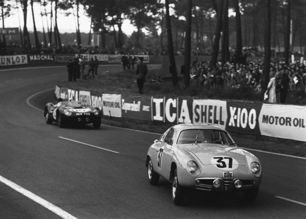 Le Mans, France. 21st - 22nd June 1958 Marcel Lauga/Jean Hebert (Alfa Romeo Giulietta Zagato), retired leads Bruce Halford/Brian Naylor (Lister Jaguar), 15th position, action. World Copyright: LAT Photographic Ref: B/W Print.
