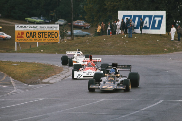 1973 Canadian Grand Prix.  Mosport Park, Ontario, Canada. 21st-23rd September 1973.  Ronnie Peterson, Lotus 72E Ford, leads Niki Lauda, BRM P160E, and Jody Scheckter, McLaren M23 Ford.  Ref: 73CAN19. World copyright: LAT Photographic