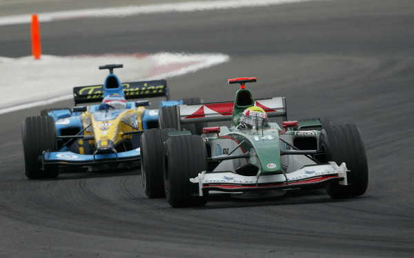2004 Bahrain Grand Prix - Sunday Race, 2004 Bahrain Grand Prix Bahrain International Circuit, Manama, Bahrain. 4th April 2004 Mark Webber, Jaguar R5 leads Fernando Alonso, Renault R24. Action. World Copyright: Steve Etherington/LAT Photographic ref: Digital Image Only