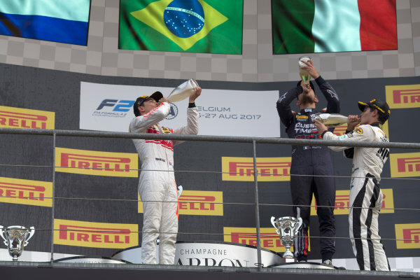 2017 FIA Formula 2 Round 8. Spa-Francorchamps, Spa, Belgium. Sunday 27 August 2017. Sergio Sette Camara (BRA, MP Motorsport) celebrates his victory on the podium with Nyck De Vries (NED, Racing Engineering) and Luca Ghiotto (ITA, RUSSIAN TIME).  Photo: Alastair Staley/FIA Formula 2. ref: Digital Image _L5R6097