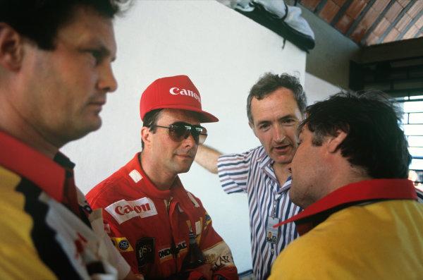 Jacarepagua, Rio de Janeiro, Brazil.1-3 April 1988.Nigel Mansell (Williams FW12-Judd), retired, talks to Patrick Head and Frank Dernie, portrait. World Copyright: LAT Photographic. Ref: 88BRA55