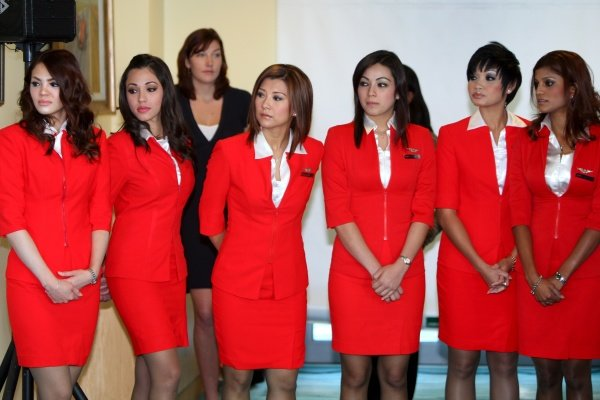 AirAsia air hostesses.AirAsia Signs As Title Sponsor for 2010 MotoGP British Grand Prix, Silverstone, England, Wednesday 10 February 2010.
