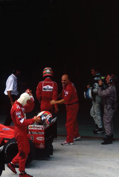 Sepang, Kuala Lumpur, Malaysia. .15-17 October 1999.  Michael Schumacher (Ferrari F399), 2nd position, follows Eddie Irvine (Ferrari F399), 1st position, into parc ferme, portrait.  World Copyright: LAT Photographic. Ref:  99 MAL 68