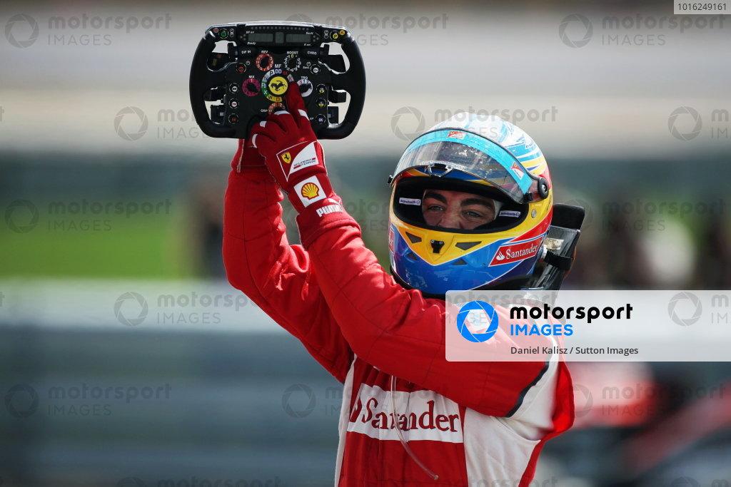 Race winner Fernando Alonso (ESP) Ferrari celebrates in parc ferme. Formula One World Championship, Rd 9, British Grand Prix, Race, Silverstone, England, Sunday 10 July 2011.  BEST IMAGE
