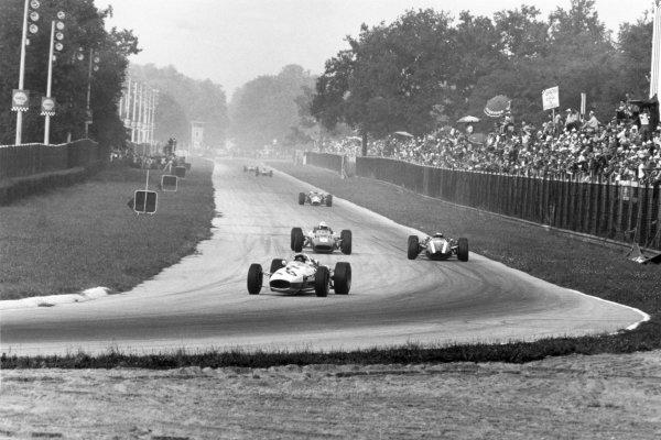 1966 Italian Grand Prix.Monza, Italy. 4 September 1966.Richie Ginther, Honda RA273, retired, leads Ludovico Scarfiotti, Ferrari 312, 1st position, Jochen Rindt, Cooper T81-Maserati, 4th position, and Jim Clark, Lotus 43-BRM, retired, action.World Copyright: LAT PhotographicRef: 1370/4