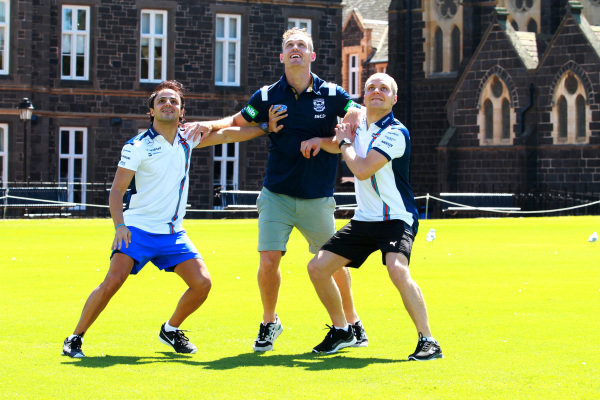 Joel Selwood (AUS) AFL Player with Felipe Massa (BRA) Williams and Valtteri Bottas (FIN) Williams at an Aussie Rules skills session at Formula One World Championship, Rd1, Australian Grand Prix, Preparations, Albert Park, Melbourne, Australia, Wednesday 11  March 2015.