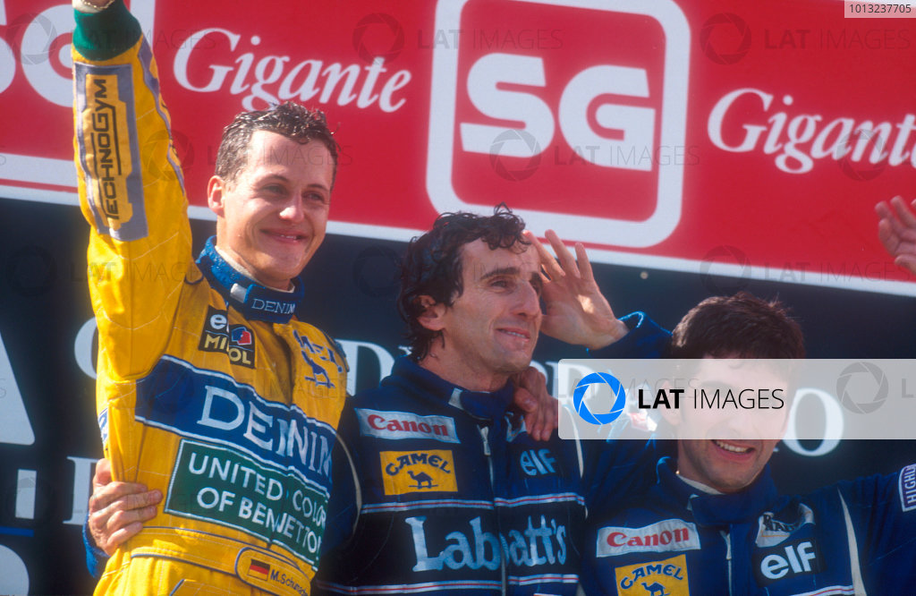 Estoril, Portugal.24-26 September 1993.Michael Schumacher (Benetton Ford) celebrates 1st position on the podium with Alain Prost, 2nd position and Damon Hill, 3rd position (both Williams Renault).Ref-93 POR 11.World Copyright - LAT Photographic