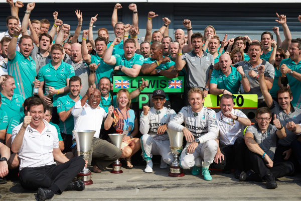 Autodromo Nazionale di Monza, Monza, Italy. Sunday 7 September 2014. Lewis Hamilton, Mercedes AMG, 1st Position, Nico Rosberg, Mercedes AMG, 2nd Position, Toto Wolff, Executive Director (Business), Mercedes AMG, Paddy Lowe, Executive Director (Technical), Mercedes AMG, and the Mercedes AMG team celebrate. World Copyright: Steve Etherington/LAT Photographic. ref: Digital Image SNE15860
