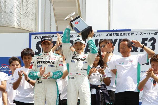 2010 Japanese Formula Three ChampionshipOkayama, Japan. 4th September 2010.2010 Champion Yuji Kunimoto ( #1 PETRONAS TEAM TOM'S ) podium.World Copyright: Yasushi Ishihara/LAT Photographicref: 2010JF3_R12_011
