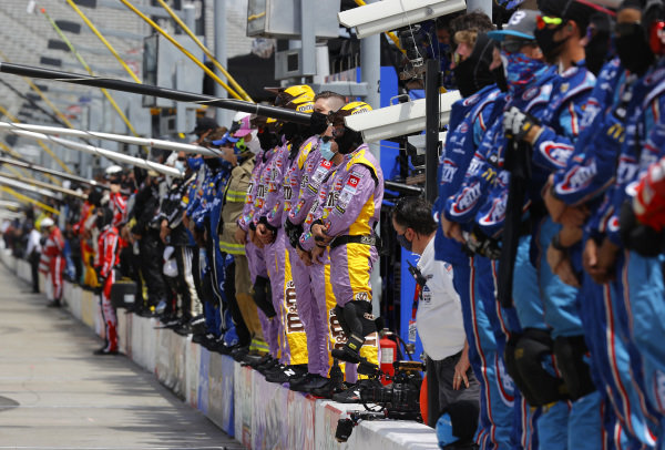 Crew members pause and stand on pit wall for a moment of listening in reflection of recent social unrest, Copyright: Chris Graythen/Getty Images.