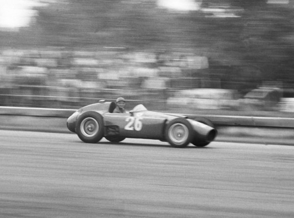 1956 Italian Grand Prix.Monza, Italy. 31/8-2/9 1956.Juan Manuel Fangio (in Peter Collins' Lancia-Ferrari D50 801), 2nd position, clinching the World Championship for the fourth time. Collins handed his car over to Fangio after the latter had retired, thus giving Fangio the title.World Copyright - LAT Photographic