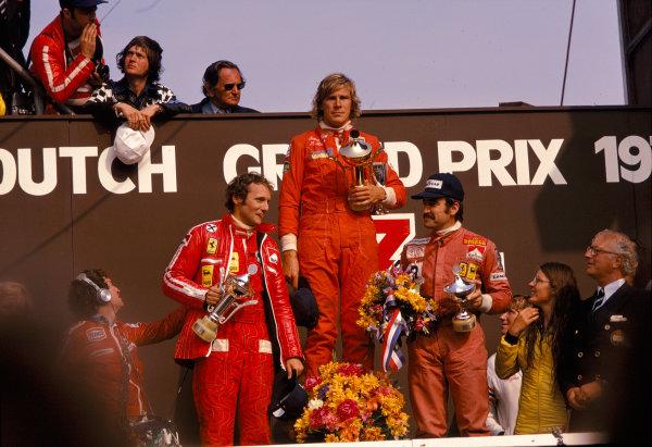 1975 Dutch Grand Prix.Zandvoort, Holland.20-22 June 1975.James Hunt (Hesketh Ford) 1st position, Niki Lauda (Ferrari) 2nd position and Clay Regazzoni (Ferrari) 3rd position on the podium.Ref-75 HOL 15.World Copyright - LAT Photographic