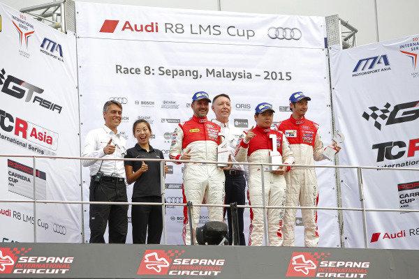 (L to R): Daniel Bilski (HKG) B-Quik Racing, Andrew Kim (KOR) E-Rain Racing Team and Alex Au (HKG) CTVS Racing Team celebrate on the Amateur Cup podium at Audi R8 LMS Cup, Rd4, Sepang, Malaysia, 4-6 September 2015.