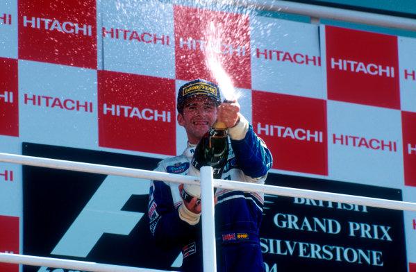 1994 British Grand Prix.Silverstone, England.8-10 July 1994.Damon Hill (Williams Renault) celebrates 1st position on the podium. Ref-94 GB 10.World Copyright - LAT Photographic
