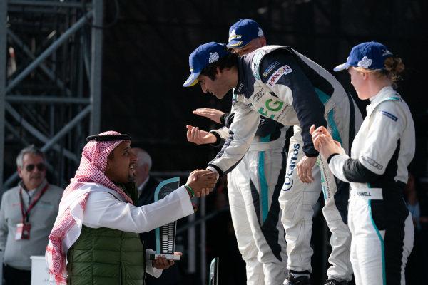 Race winner Sérgio Jimenez (BRA), ZEG iCarros Jaguar Brazil receives his trophy on the podium
