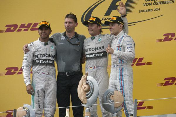 Podium group photo: Lewis Hamilton, 2nd position, Mercedes AMG F1 Team Chief Strategist James Vowls, race winner Nico Rosberg, and Valtteri Bottas, 3rd position.