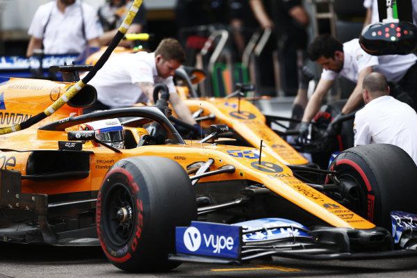 Carlos Sainz Jr., McLaren MCL34, and Lando Norris, McLaren MCL34, in the pit lane