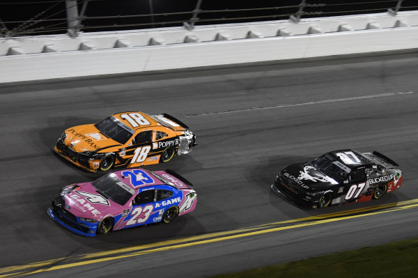 #23: Jason White, RSS Racing, Chevrolet Camaro A-Game #18: Daniel Hemric, Joe Gibbs Racing, Toyota Supra Poppy Bank