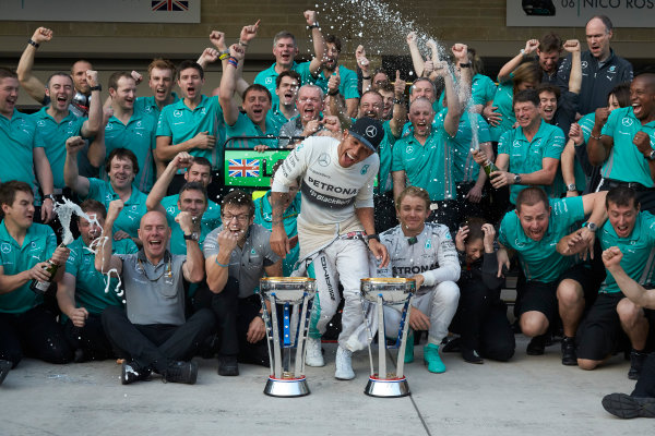 Circuit of the Americas, Austin, Texas, United States of America. Sunday 2 November 2014. Lewis Hamilton, Mercedes AMG celebrates with the team and Nico Rosberg, Mercedes AMG after winning the race. World Copyright: Steve Etherington/LAT Photographic. ref: Digital Image SNE25056