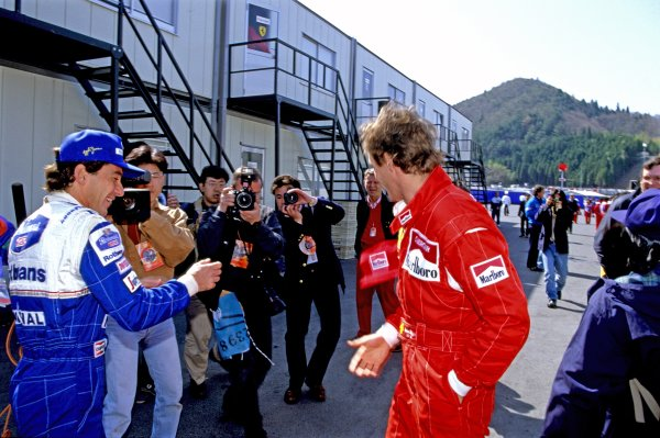 1994 Pacific Grand Prix.Tanaka International, Aida, Japan.15-17 April 1994.Ayrton Senna (Williams Renault) jokes with former team mate Gerhard Berger (Ferrari 412T1) , in the paddock, portrait.Ref-94 PAC 62World Copyright - LAT Photographic