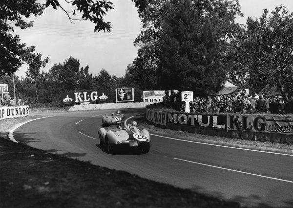 Le Mans, France. 22nd - 23rd June 1957.Lucien Bianchi/Georges Harris (Ferrari 500 TRC), 7th position, follows Giorgio Scarlatti/Jo Bonnier ( Maserati 300S), retired, action. World Copyright: LAT Photographic.Ref: Autocar Glass Plate C49322.