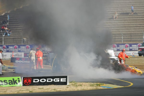 2004 American Le Mans Series (ALMS)Infineon Grand Prix of Sonoma, Sears Point. 16th - 18th July. Dale Earnhardt Jr. walks away from crash (left side of frame) as fire engulfs car.World Copyright: Richard Dole/LAT Photographicref: Digital Image Only