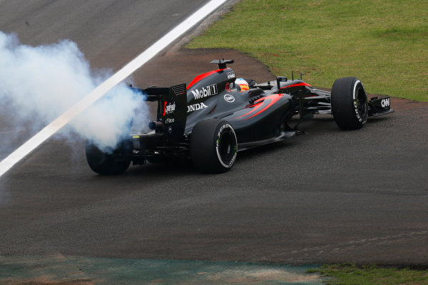 Interlagos, Sao Paulo, Brazil. Friday 13 November 2015. Fernando Alonso, McLaren MP4-30 Honda pulls off the track with a smoking engine. World Copyright: Alastair Staley/LAT Photographic. ref: Digital Image _R6T2867
