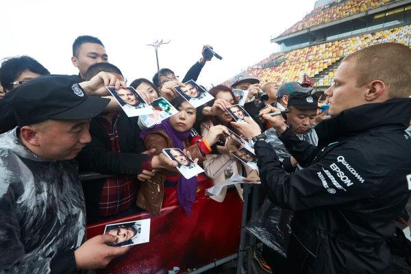 Shanghai International Circuit, Shanghai, China.  Thursday 6 April 2017. Valtteri Bottas, Mercedes AMG, signs autographs for fans. World Copyright: Steve Etherington/LAT Images ref: Digital Image SNE16012