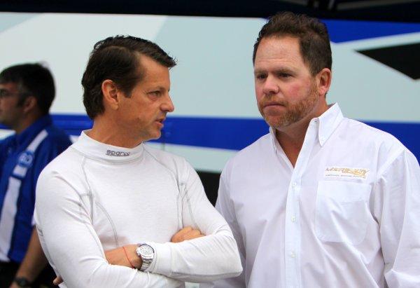 29-31 March, 2012, Birmingham, Alabama USA Rolex 24 winner Oswaldo Negri , left, talks with his car owner Michael Shank in the paddock.(c)2012, R.D. Ethan LAT Photo USA