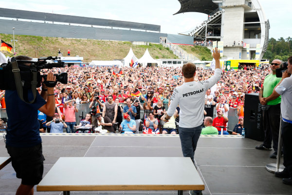Hockenheim, Germany. Saturday 30 July 2016. Nico Rosberg, Mercedes AMG, waves to an enthusiastic crowd while a cameraman films him on stage. World Copyright: Andy Hone/LAT Photographic ref: Digital Image _ONZ7537