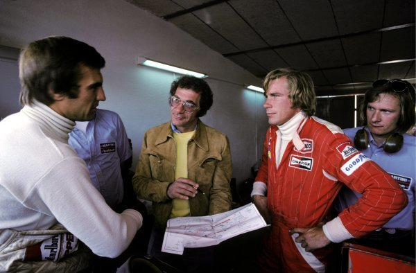 Fourth placed Carlos Reutemann (ARG) Brabham (Left) discusses the track layout with race winner James Hunt (GBR) McLaren (Right) to a film director (Centre), who was filming onboard coverage of the circuit using a Brabham BT45.Spanish Grand Prix, Rd4, Jarama, 2 May 1976.BEST IMAGE