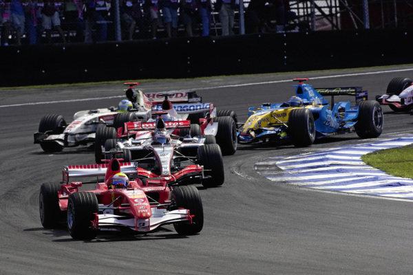 Felipe Massa, Ferrari 248 F1 leads Kimi Räikkönen, McLaren MP4-21 Mercedes, Jarno Trulli, Toyota TF106B, Rubens Barrichello, Honda RA106 and Fernando Alonso, Renault R26 at the start.