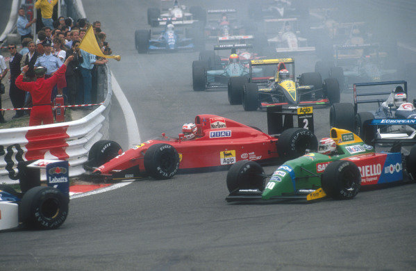 1990 Belgian Grand Prix.Spa-Francorchamps, Belgium.24-26 August 1990.Nigel Mansell (Ferrari 641) was hit from behind by Nelson Piquet (Benetton B190 Ford) on the approach to La Source Hairpin. He took Prost's spare car for the second and third starts but exited the race suffering with bad oversteer.Ref-90 BEL 08.World Copyright - LAT Photographic