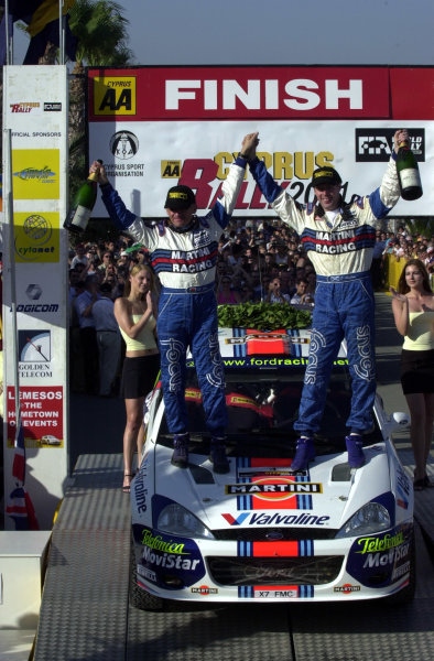 2001 World Rally ChampionshipCyprus Rally June 1-3, 2001Colin McRae and Nicky Grist celebrate victory on the podium.Photo: Ralph Hardwick/LAT
