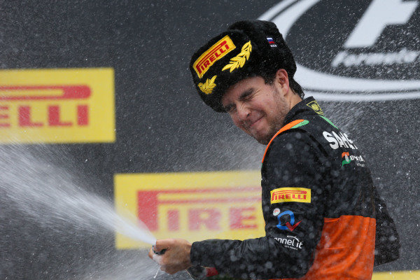 Sergio Perez (MEX) Force India celebrates with champagne on the podium at Formula One World Championship, Rd15, Russian Grand Prix, Race, Sochi Autodrom, Sochi, Krasnodar Krai, Russia, Sunday 11 October 2015.