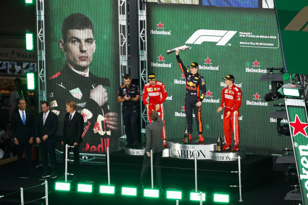 Sebastian Vettel, Ferrari, 2nd position, Max Verstappen, Red Bull Racing, 1st position, and Kimi Raikkonen, Ferrari, 3rd position, on the podium