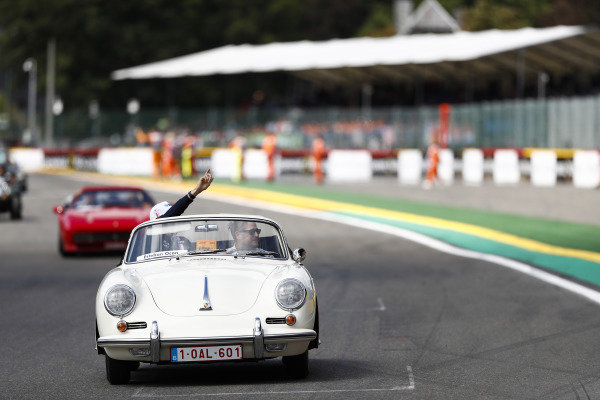 Esteban Ocon, Racing Point Force India, waves from a Porsche 356, on the drivers' parade.