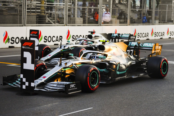 Valtteri Bottas, Mercedes AMG W10, and Lewis Hamilton, Mercedes AMG F1 W10, park their cars after Qualifying