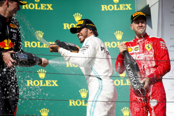 Max Verstappen, Red Bull Racing, 2nd position, Lewis Hamilton, Mercedes AMG F1, 1st position, and Sebastian Vettel, Ferrari, 3rd position, celebrate with Champagne on the podium
