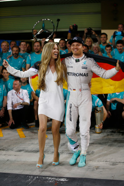 Yas Marina Circuit, Abu Dhabi, United Arab Emirates. Sunday 27 November 2016. Nico Rosberg, Mercedes AMG, 2nd Position and new World Champion, celebrates with his team, friends and wife Vivian. World Copyright: Andrew Hone/LAT Photographic ref: Digital Image _ONY8158