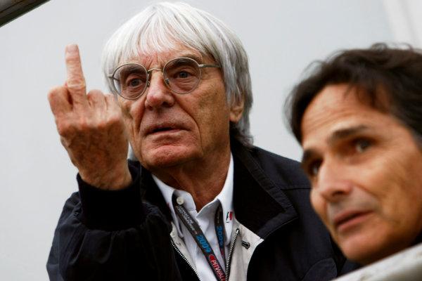 Interlagos, Sao Paulo, Brazil.16th October 2009.Bernie Ecclestone gives the finger in the paddock. Portrait.World Copyright: Charles Coates/LAT Photographicref: Digital Image _26Y9561