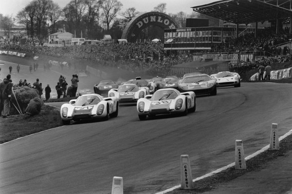Brands Hatch, England. 7th April 1968.Gerhard Mitter / Ludovico Scarfiotti (Porsche 907) and Jo Siffert / Hans Herrmann (Porsche 907), lead into the first corner at the start of the race, action.World Copyright: LAT Photographic.Ref: L68 / 310 / 2