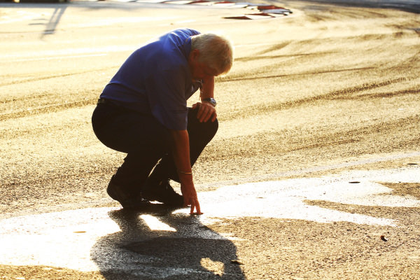 Charlie Whiting (GBR) FIA Delegate and Herbie Blash (GBR) FIA Delegate inspect the track after the kerbs were becoming loose, which delayed free practice 1. 