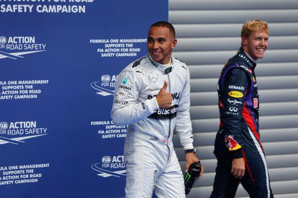 Spa-Francorchamps, Spa, Belgium. 24th August 2013. Lewis Hamilton, Mercedes AMG celebrates pole position in Parc Ferme. World Copyright: Andrew Ferraro/LAT Photographic. ref: Digital Image _79P7717.