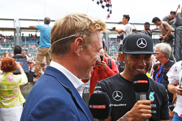Silverstone, Northamptonshire, England. Sunday 05 July 2015. Lewis Hamilton, Mercedes AMG, is interviewed on Sky Sports F1 Photo:  Sam Bloxham/LAT Photographic ref: Digital Image _G7C3130