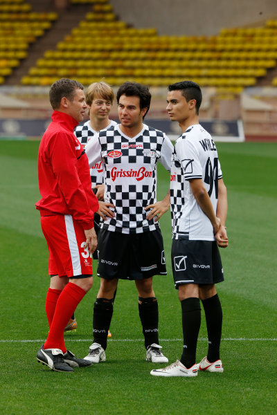 Monte Carlo, Monaco. Tuesday 19 May 2015. Tom Kristensen, Johnny Cecotto Jr, Sergio Perez, Force India, and Pascal Wehrlein, Reserve Driver, Mercedes AMG, at the 22nd World Stars football match. World Copyright: Charles Coates/LAT Photographic. ref: Digital Image _N7T7015