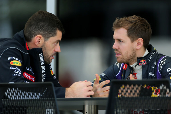 Guillaume Rocquelin (FRA) Red Bull Racing Race Engineer and Sebastian Vettel (GER) Red Bull Racing. Formula One Testing, Day One, Bahrain International Circuit, Sakhir, Bahrain, Wednesday 19 February 2014.