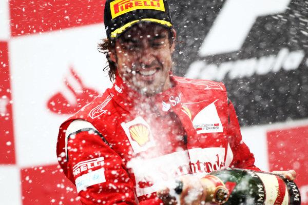 Fernando Alonso (ESP) Ferrari on the podium.  Formula One World Championship, Rd 10, German Grand Prix, Race, Nurburgring, Germany, Sunday 24 July 2011.  BEST IMAGE