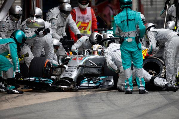 Circuit de Catalunya, Barcelona, Spain. Sunday 11 May 2014. Lewis Hamilton, Mercedes F1 W05 Hybrid, makes a pit stop. World Copyright: Glenn Dunbar/LAT Photographic. ref: Digital Image _W2Q8060