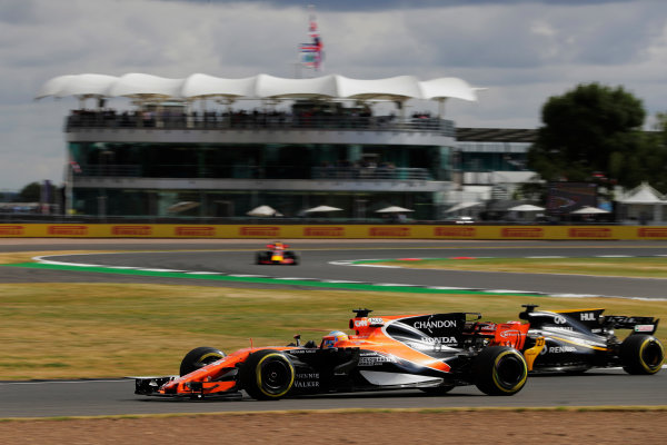 Silverstone, Northamptonshire, UK.  Friday 14 July 2017. Fernando Alonso, McLaren MCL32 Honda, leads Nico Hulkenberg, Renault R.S.17 and a Red Bull. World Copyright: Zak Mauger/LAT Images  ref: Digital Image _54I4539